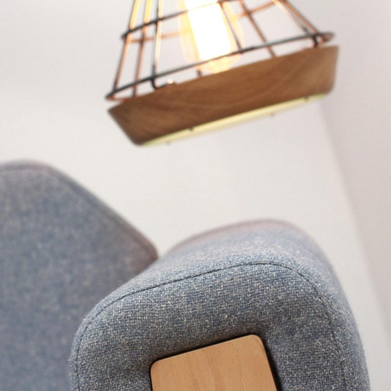 Arm of Liqui Hove Club Chair (in tweed) and side view of Liqui Work Lamp (oak and steel)