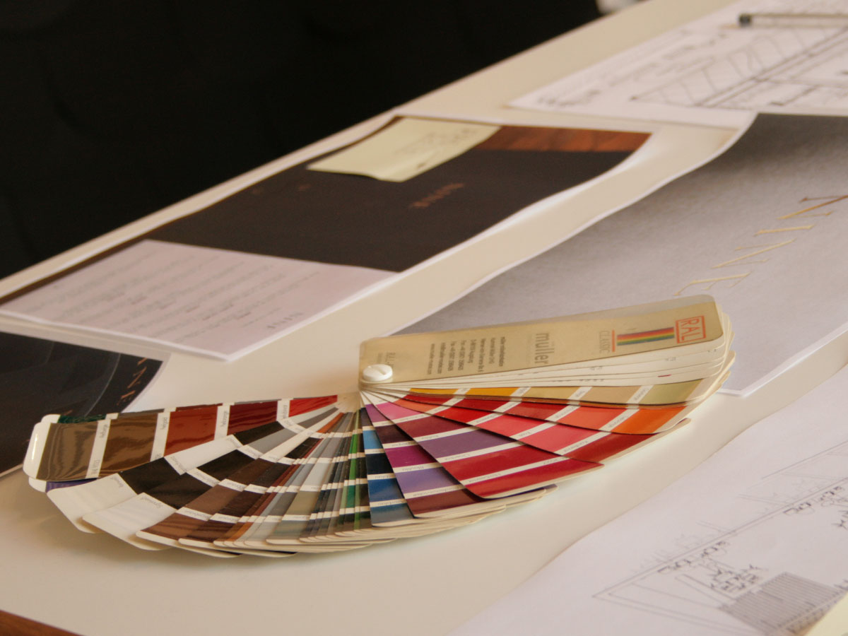 Liqui-Consultants-RAL colour swatch book fanned out on a designer's desk.