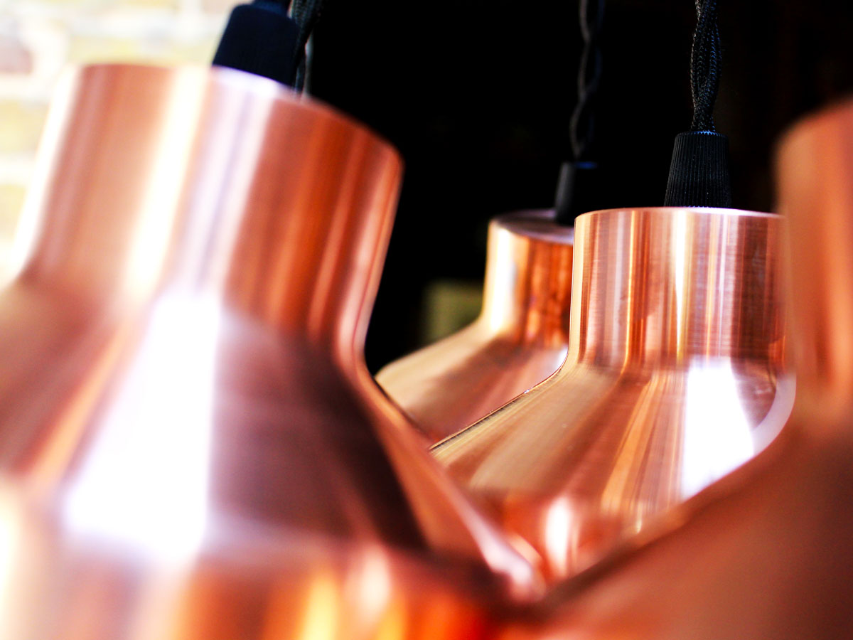 Liqui-Products-Lighting-Copper Naked Cell Lamps showing close-up of polished copper light shades