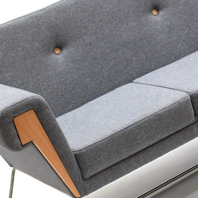 The Hove Club Sofa by Liqui in sustainable Main Line Flax grey tweed showing the oak insert on the face of an arm with part of the back and seat cushions.