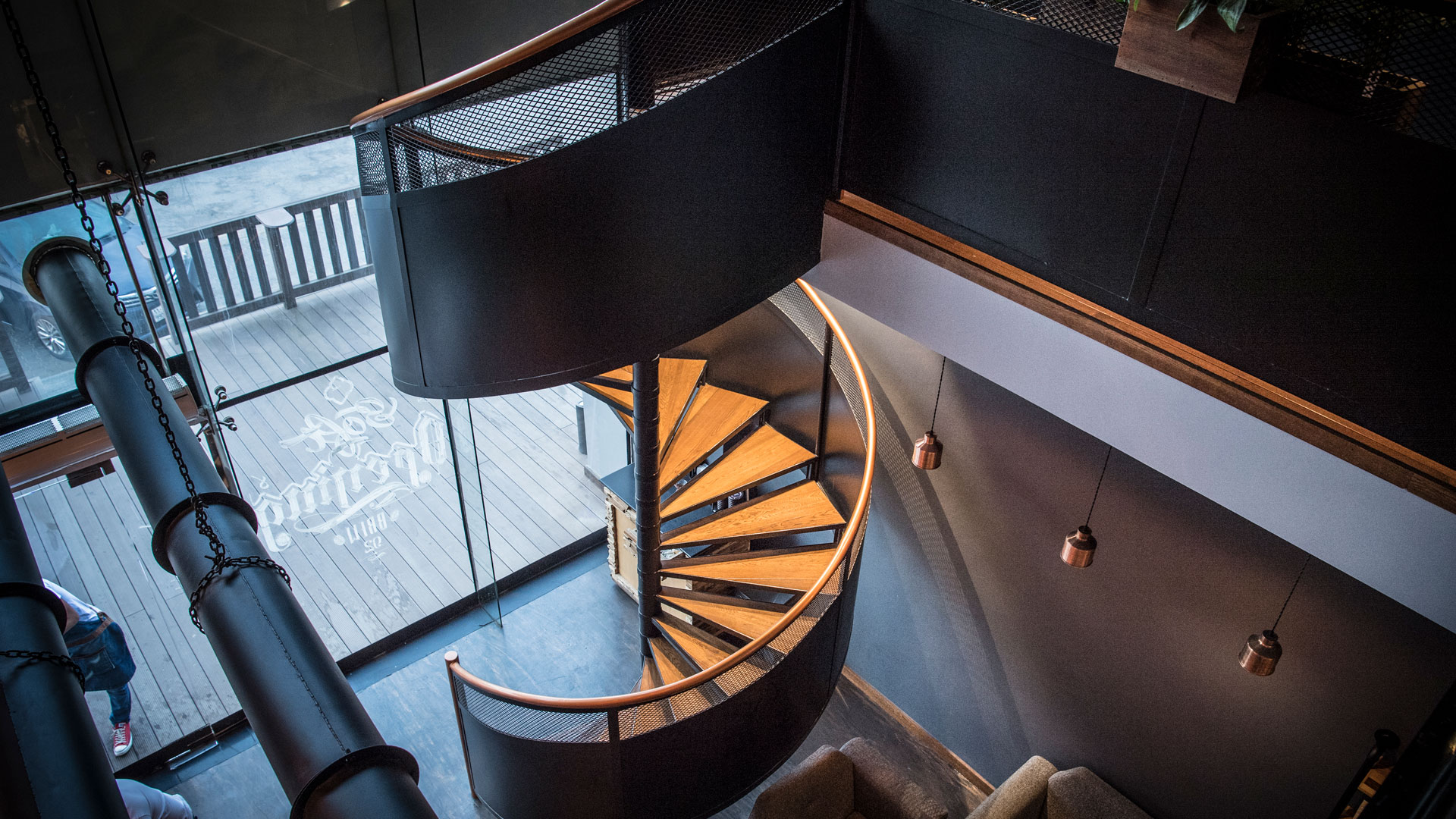 Liqui Commercial Interiors - Brew92-coffee shop design showing the bespoke spiral staircase.