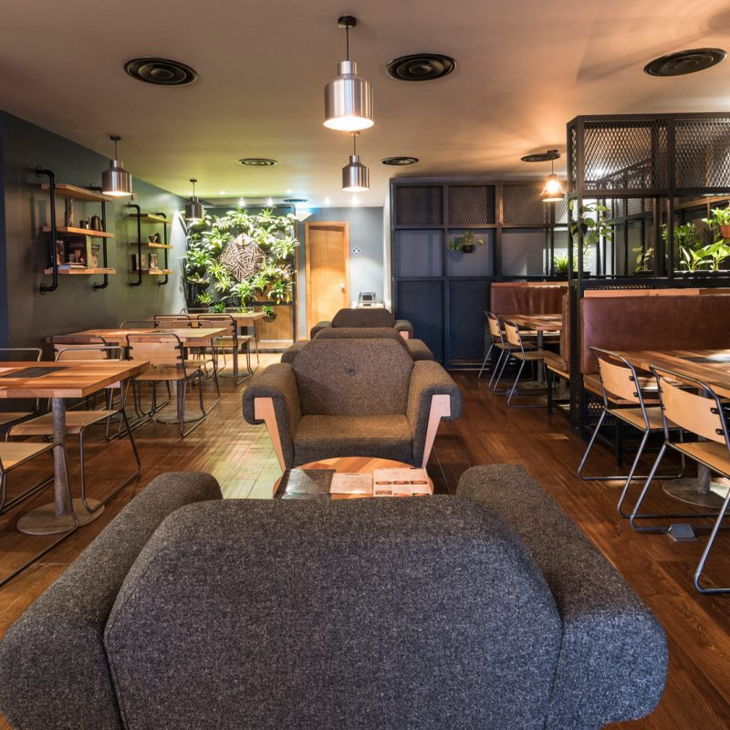 Inside view of the Brew92 coffee shop showing Liqui furniture and lighting with interior design by Liqui