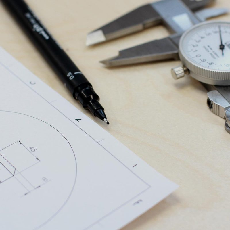 LIQUI - BUILD AND PROJECT MANAGEMENT - design-consultancy2 - drawing pen, callipers and plan.