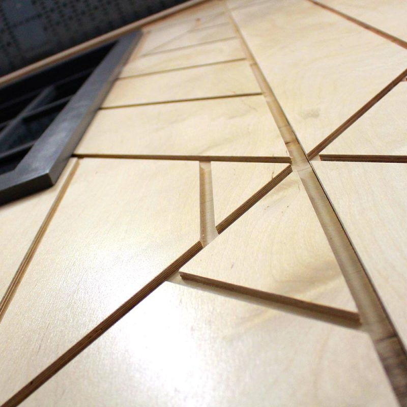 Liqui Interiors - Detail of decorative wall panel in Seedrs office interior (CNC routed birch ply)