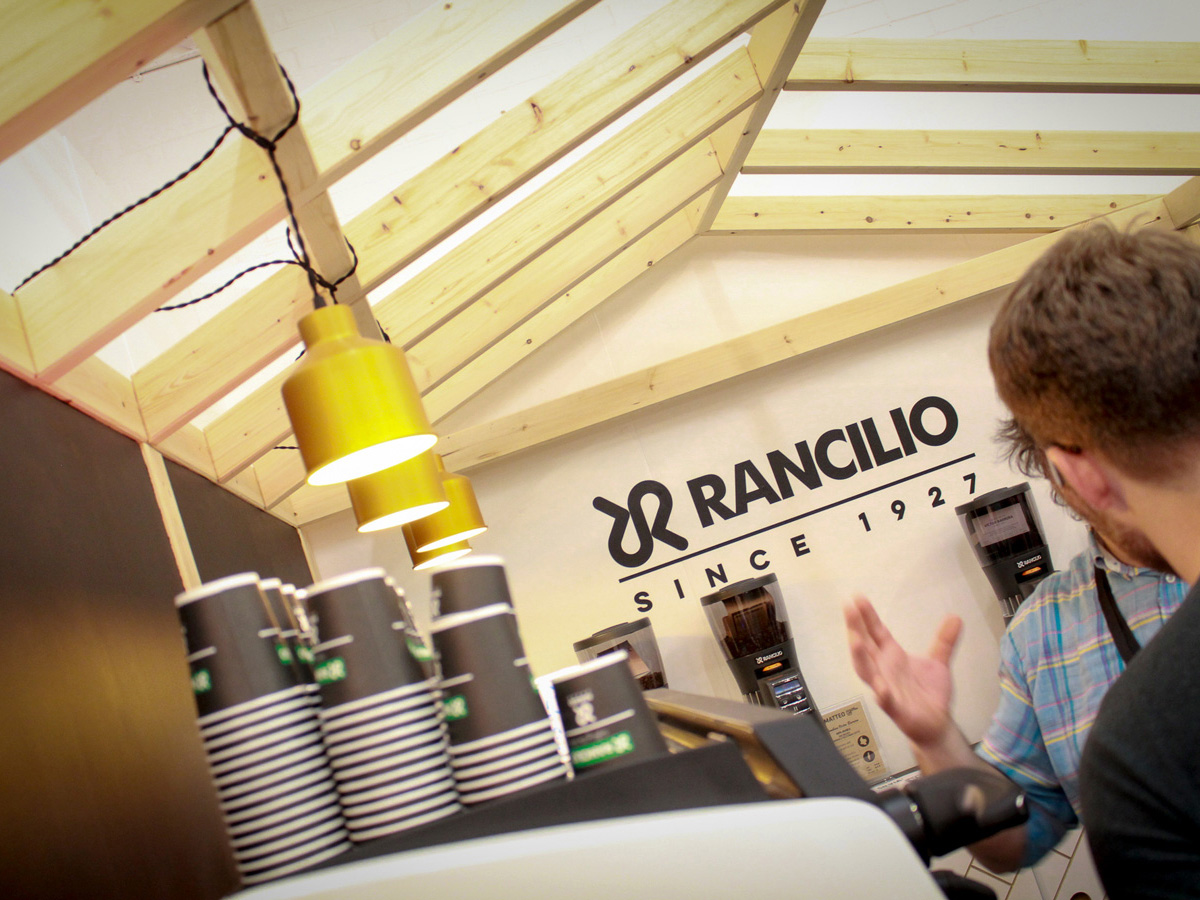 Liqui Exhibition Stand Design - Rancilio trade stand at London Coffee Festival showing roof structure with hanging Cell Lights