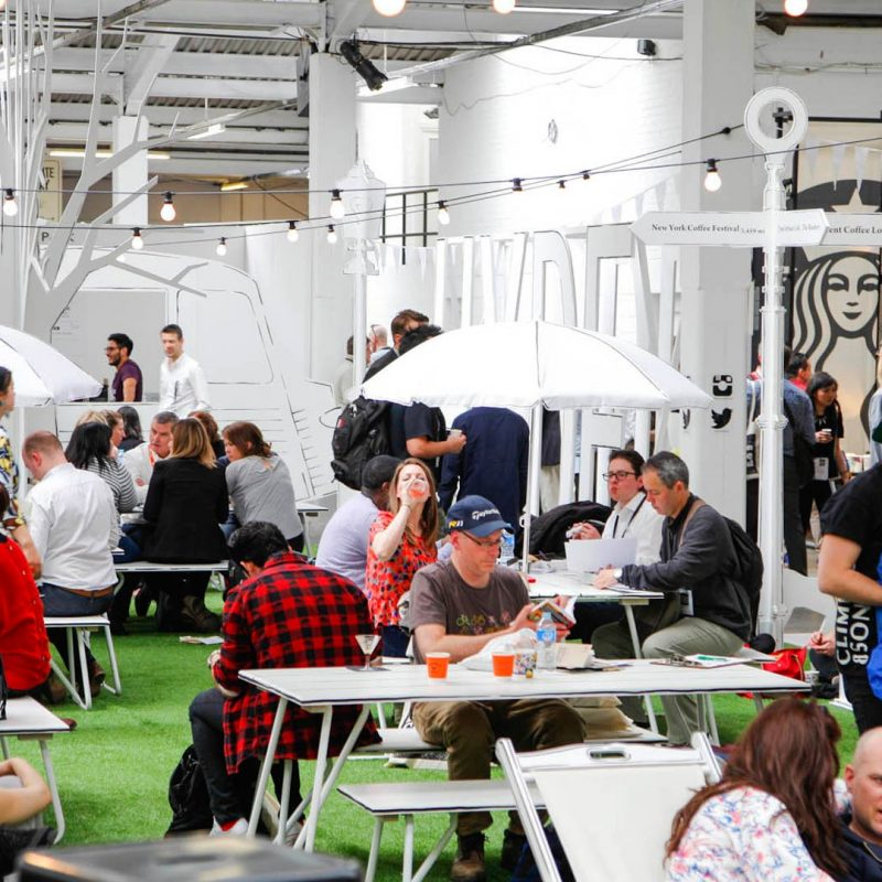 Liqui Exhibition Design - London Coffee Festival - Hyde Park social area - showing people sitting and standing while socialising.