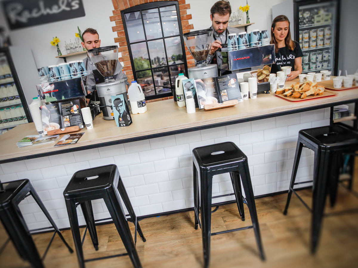Liqui Exhibition Stand Design - Rachel's organic trade stand at London Coffee Festival showing bar stools in front of a bespoke counter.