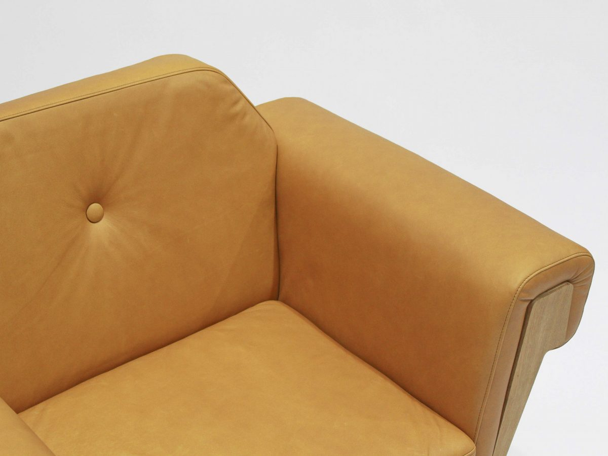 Liqui Hove Club Contract Chair - Close up view showing sustainably sourced oak inserts - upholstered in leather.