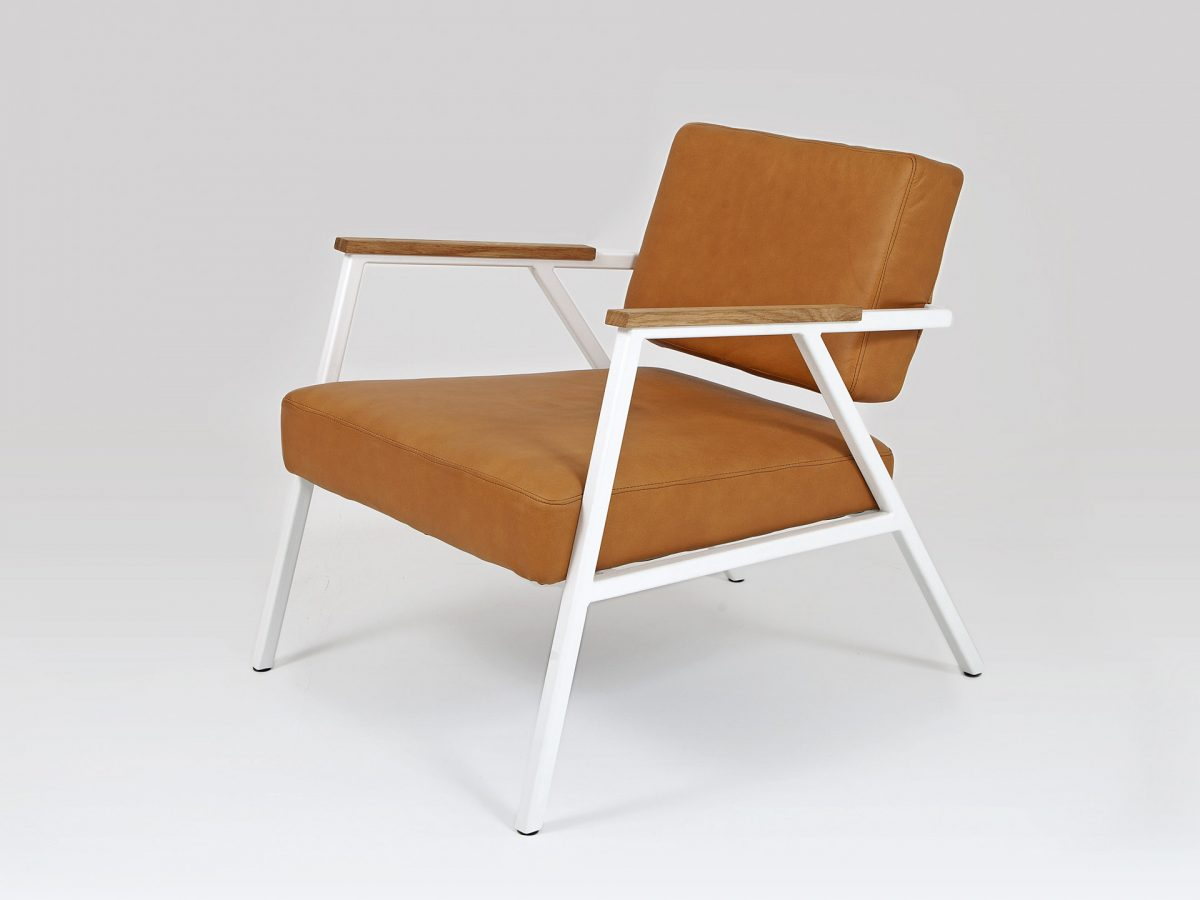 Liqui Studio Commercial Easy Chair - Three quarter view showing the steel frame powder coated in white with leather upholstered seat and back rest.