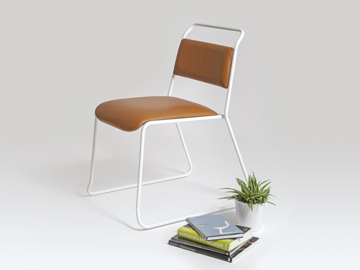 Liqui Contract Trapeze Chair - Three quarter view showing powder coated stainless steel tubular frame in white with sustainably sourced Birch ply seat and back upholstered in leather.