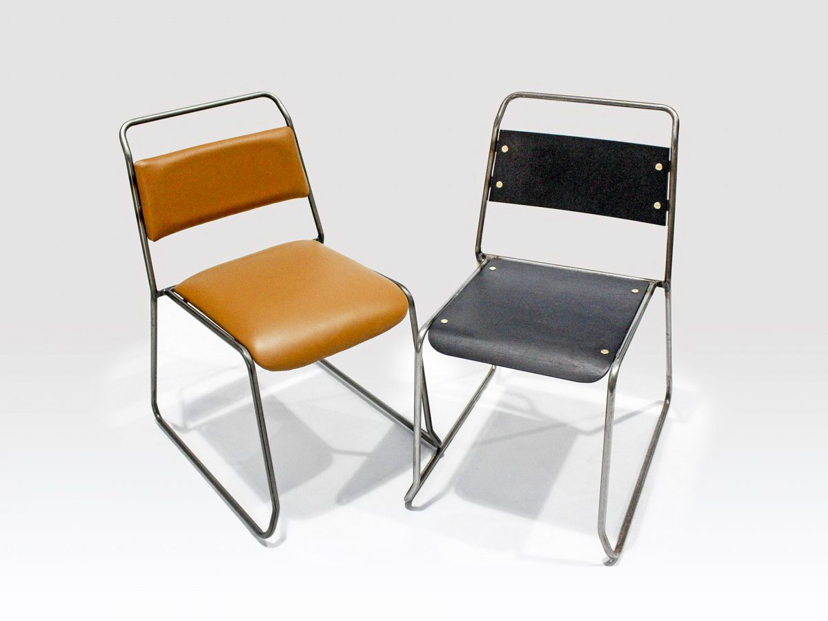 Liqui Contract Trapeze Chair - View of two chairs with stainless steel tubular frames - one with dark stained sustainably sourced Birch ply seat and back the other upholstered in leather.